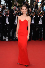 Natalie Portman went for no-frills sophistication in a strapless red column dress by Christian Dior at the Cannes Film Festival opening ceremony.