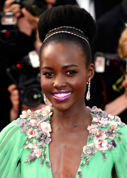 Lupita Nyong'o worked the Cannes Film Festival opening ceremony red carpet rocking an afro puff.