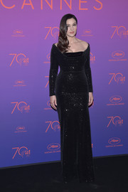Monica Bellucci looked supremely elegant in a Swarovski crystal-embellished off-the-shoulder gown by Vivienne Westwood Couture at the Cannes Film Festival opening gala dinner.