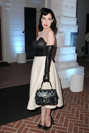 Dita Von Teese showed off her decadent Fall 2010 handbag, while hitting the opening of Louis Vuitton in Santa Monica.