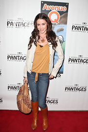Shannon Elizabeth looked casual at the premiere of 'Avenue Q' in cognac leather knee high boots.