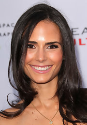 Jordana Brewster added instant glam to her look with fluttering long lashes.