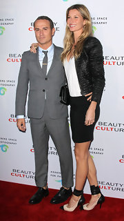 Gisele Bundchen paired her monochromatic style with cotton-raffia and black leather ankle cuff pumps.