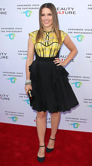 Sophia Bush donned glittery black Mary Jane pumps with her black and yellow Zac Posen frock.