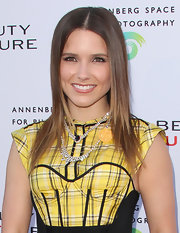 Sophia Bush paired her yellow plaid dress with a diamond statement necklace.