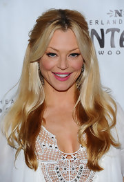 Charlotte Ross parted her golden locks down the center and swept her hair back in a half up hairstyle.