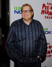 Comedian Drew Carey paired his classic jeans with a printed button down shirt.