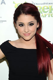 Ariana pulled her hair back in a low ponytail. Her sleek 'do was the perfect way to accent her flawless makeup.