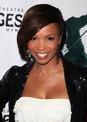 Elise Neal offset her look with  gemstone chandelier earrings.