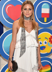 Olivia Palermo completed her ensemble with a modern-chic geometric clutch.