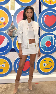 Chanel Iman tempered the sexiness with a white bomber jacket.