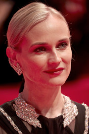 Diane Kruger complemented her bedazzled dress with a diamond ear cuff by Messika.