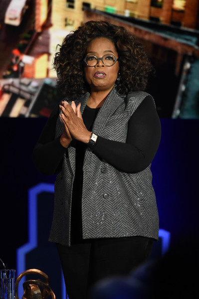 Oprah Winfrey was casual in a gray herringbone vest layered over a black sweater at 'Oprah's SuperSoul Conversations.'