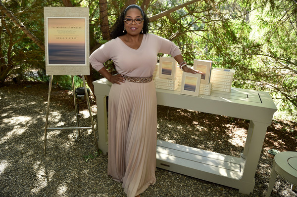 Oprah Winfrey dressed up her sweater with a pleated maxi skirt.