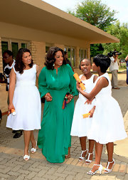 Oprah Winfrey looked divine in a green silk evening dress while visiting the Leadership Academy for Girls.