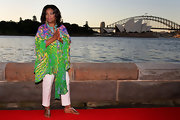 Oprah Winfrey attended a party at the Royal Botanic Gardens in Sydney wearing a colorful print caftan.