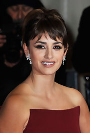 Penelope Cruz attended the 2012 BAFTA Awards wearing a pair of 15-carat pear and oval cut diamond earrings set in white gold.