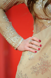 Kimberley Walsh's red nails looked striking against her nude dress during the Orange British Academy Film Awards.