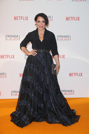 Selenis Leyva was a head turner in her floor-sweeping plaid skirt at the 'Orange is the New Black' Europe premiere.