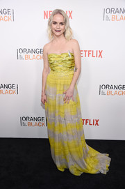 Taryn Manning looked totally glam in a strapless chartreuse and gray gown at the New York premiere of 'Orange is the New Black.'