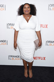 Adrienne C. Moore teamed her alluring frock with nude gladiator heels.