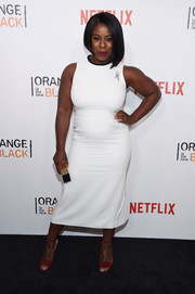 Uzo Aduba accessorized with red ankle-strap sandals for a hint of color to her look.