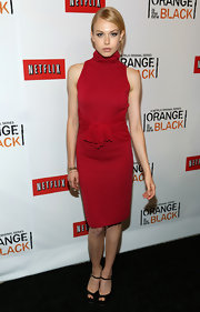 Penelope Mitchell rocked a crimson-hued turtleneck cocktail dress with a ruched waist.