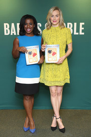 Taylor Schilling wore a sunny yellow spotted dress for the 'OITNB Presents: The Cookbook' event.