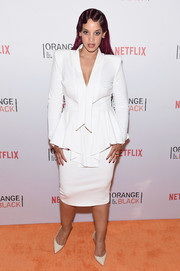 Dascha Polanco was '40s-chic at the Orangecon fan event in a white skirt suit with elaborate peplum detailing.