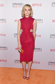 Sticking to clean, minimalist lines, Taylor Schilling accessorized with a gold Lee Savage Broken Space clutch.