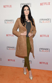 Laura Prepon topped off her ensemble with a tan suede coat by H&M.