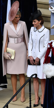 Kate Middleton kept it classy in a white Catherine Walker coat dress with black trim at the Order of the Garter Service.