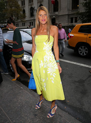 Anna dello Russo channeled her inner princess in an embroidered yellow strapless dress by Oscar de la Renta during the brand's fashion show.
