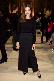 Julia Restoin-Roitfeld paired her top with a front-slit maxi skirt.