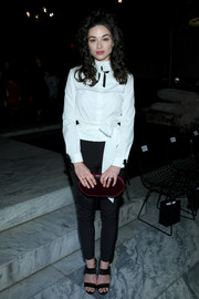 Crystal Reed was spotted during New York Fashion Week wearing a belted white button-down by Carolina Herrera.