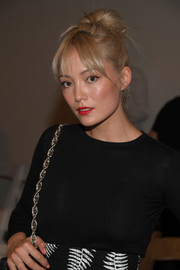Pom Klementieff swept her hair up into a messy top knot for the Oscar de la Renta fashion show.
