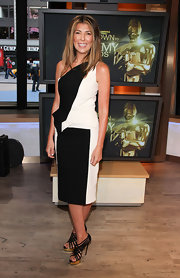A pair of black strappy sandals provided a sexy finish to Nina Garcia's look.
