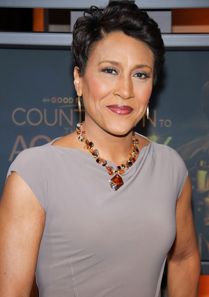 Robin Roberts added a bit of flair to her simple dress with a colorful glass beaded necklace.
