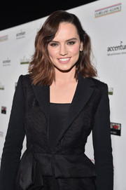Daisy Ridley looked chic with her short wavy cut that showed off her brunette tresses at the 2016 Oscar Wilde Awards.