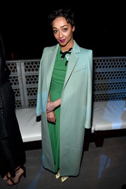 Ruth Negga covered up in a long seafoam-green coat by Max Mara while attending the 2017 Oscar Wilde Awards.
