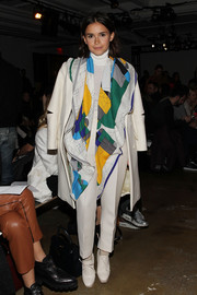 Miroslava Duma added a dose of color to her all-white outfit with a patterned scarf when she attended the Ostwald Helgason fashion show.