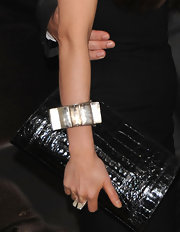 China Chow paired her textured clutch with a silver bangle bracelet.