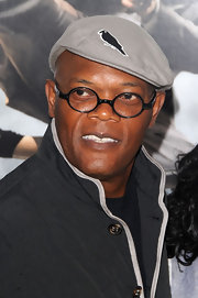 Samuel L. Jackson paired his round sunglasses with a grey newsboy cap.
