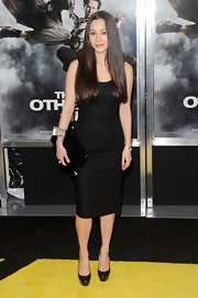 China Chow paired her platform pumps with a patent leather clutch.