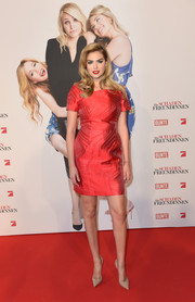 Kate Upton sheathed her curves in a red Fendi cocktail dress featuring a subtle pattern for the German premiere of 'The Other Woman.'