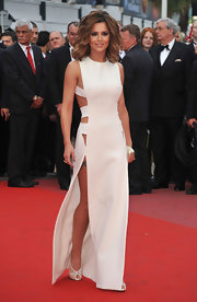 Cheryl shocked the crowd in a white bandage-style, cutout dress with a thigh-high slit.