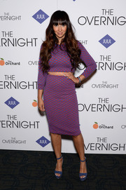 Jackie Cruz kept the colors coming with a pair of blue suede platform sandals.