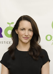 Kristin Davis attended the Oxfam Sisters On the Planet Summit wearing her long hair in subtle silky waves.