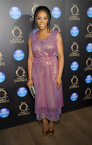 June Ambrose arrived at the VIP screening of 'Oz' wearing a pink glittery dress.