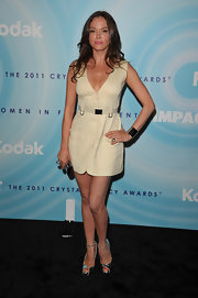 Rose McGowan gave her cream mini dress a sultry finish with silver platform peep-toes with ankle straps.